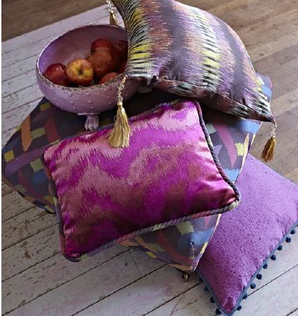 Prestigious Textiles -  Eclipse Fabric Collection - Rich jewel shades including blue and purple making up striking patterns on four scatter cushions with tassels and fringing