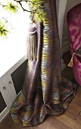 Prestigious Textiles -  Eclipse Fabric Collection - A tasselled tieback around curtains made from subtly patterned, luxurious fabric made in dark purple, grey, blue and green