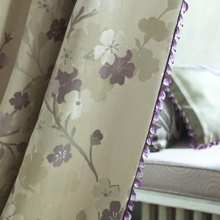 Prestigious Textiles -  Elysee Fabric Collection - Light green curtains with classic white and purple flower impressions and purple bead lining from the Elysee fabric collection