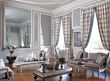 Prestigious Textiles -  Empire Fabric Collection - Grey and white fabrics making up plain armchairs and sofas, striped curtains and cushions, with a mirrored coffee table