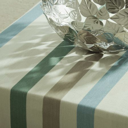 Prestigious Textiles -  English Rose Fabric Collection - A close-up picture of a white tablecloth with blue and gold stripes from the English rose fabric collection