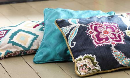 Prestigious Textiles -  Explore Fabric Collection - Bold modern cushion designs - diamonds, intricate florals and silky block colour turquoise blue