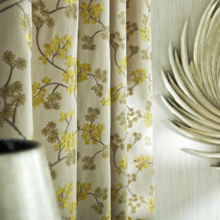 Prestigious Textiles -  Exquisite Fabric Collection - Cream white curtain with mimosa yellow leaf pattern for a modern house setting