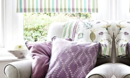 Prestigious Textiles -  Fiorella Fabric Collection - Pink, green and blue striped Roman blind with diamond pattern cushion and leaf and bud design throw in complementary colours