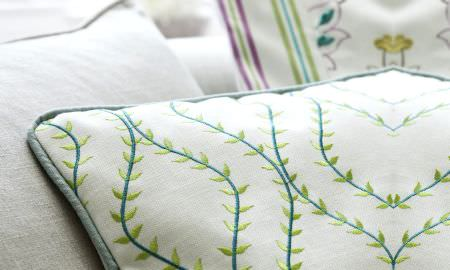 Prestigious Textiles -  Fiorella Fabric Collection - Ribbed cream cushion with small leaf design from the Fiorella Collection