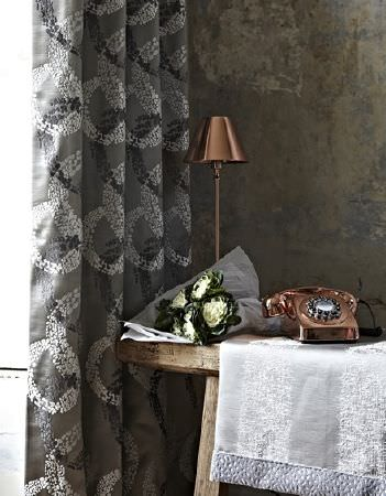 Prestigious Textiles -  Focus Fabric Collection - Modern curtain dyed in dark grey shade decorated with a pattern of circles in black and white