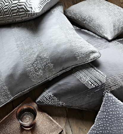 Prestigious Textiles -  Focus Fabric Collection - A collection of prestigious decorative cushions in different shades of grey with elegant decorative designs