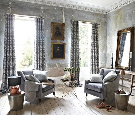 Prestigious Textiles -  Focus Fabric Collection - Set featuring two matching elegant armchairs covered with modern grey cushions and matching curtains in grey