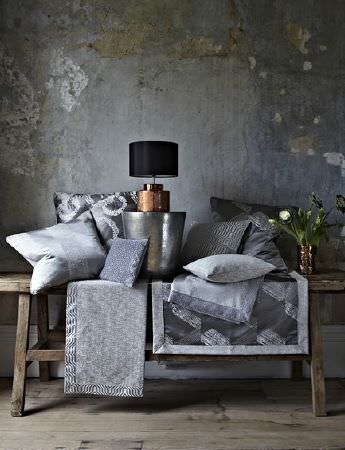 Prestigious Textiles -  Focus Fabric Collection - Elegant grey furniture covers, and a set of different silky cushions with modern decorative patterns