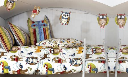 Prestigious Textiles -  Forest Friends Fabric Collection - Owl design duvet cover and stripey cushions in red, yellow, green and blue - from the Forest Friends collection