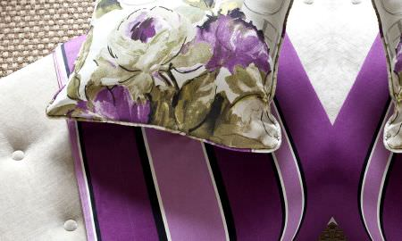 Prestigious Textiles -  Fragrant Harbour Fabric Collection - Green and purple large print floral design cushion