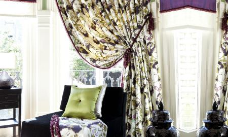 Prestigious Textiles -  Fragrant Harbour Fabric Collection - Green and purple themed living area - Slky green cushion, purple armchair, cream, purple and cream curtains