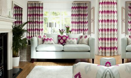 Prestigious Textiles -  Funfair Fabric Collection - Living area in shades of cream, light blue, grey and pink - zigzag design curtains and cushions, diamond design throw and cushion
