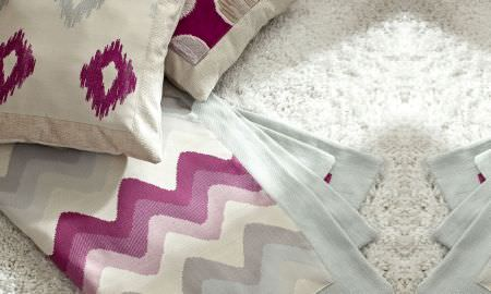Prestigious Textiles -  Funfair Fabric Collection - Throws and cushion in zigzag and diamond pattern, cream, pink and grey