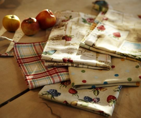Prestigious Textiles -  Garden of England Fabric Collection - Five napkins with light beige backgound with patterns of friut, floral, dots and check.