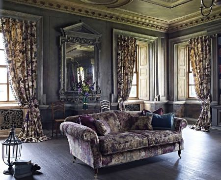 Prestigious Textiles -  Grand Palais Fabric Collection - 3 floral curtains and a large sofa with scatter cushions, all made in dark shades of purple, grey and blue, with a mirror