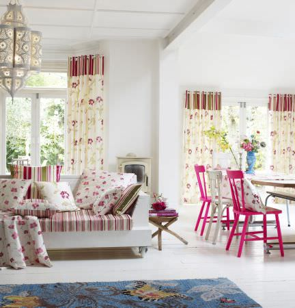 Prestigious Textiles -  Harmony Fabric Collection - Open plan living - green, pink and white stripes and florals in cushions, curtains, tablecloths
