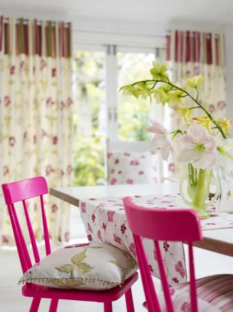 Prestigious Textiles -  Harmony Fabric Collection - Floral and striped curtains with floral and leaf design cushion in matching shades of green, pink and white.