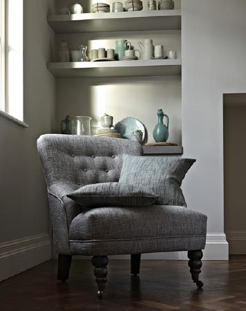 Prestigious Textiles -  Herriot Fabric Collection - Modern plain design on upholstered armchair with buttons in grey and matching grey cushions