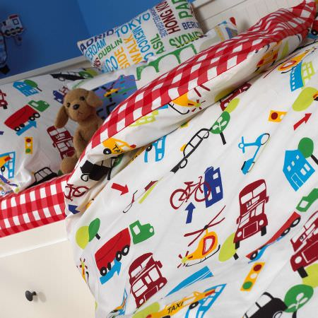Prestigious Textiles -  Home Sweet Home Fabric Collection - White bedspread with images of cars, helicopters and trucks, red and white tartan pillows for childrens bedrooms