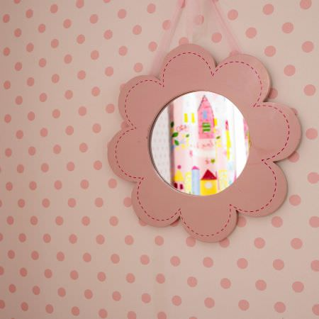Prestigious Textiles -  Home Sweet Home Fabric Collection - White fabric wallpaper with pink dots and a small mirror for a girls room