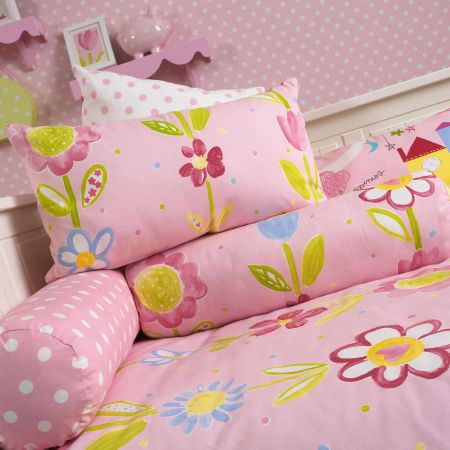 Prestigious Textiles -  Home Sweet Home Fabric Collection - Pink pillows with colourful flowers and dots, and a pink duvet for a girls bedroom