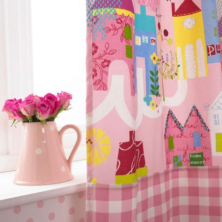 Prestigious Textiles -  Home Sweet Home Fabric Collection - Pink curtain with colourful buildings and tartan bits for a girls room from the Home Sweet Home fabric collection