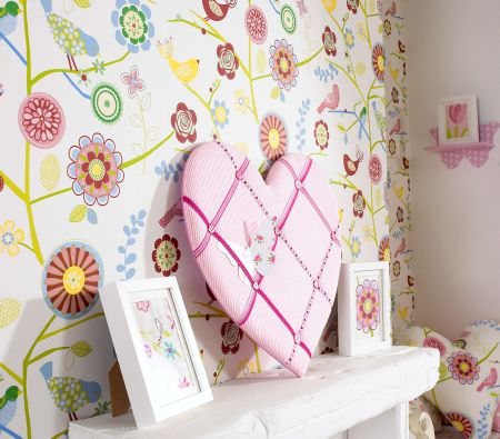 Prestigious Textiles -  Home Sweet Home Fabric Collection - White curtain with a modern abstract flower design and a heart-shaped pillow