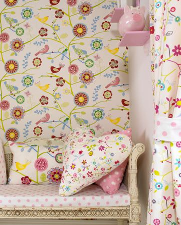 Prestigious Textiles -  Home Sweet Home Fabric Collection - A heart-shaped pillow decorated with modern flowers, and dotted pillows on an antique bench with a white seating pad with pink dots