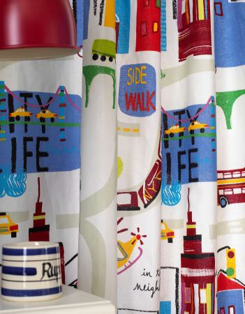 Prestigious Textiles -  Home Sweet Home Fabric Collection - A white curtain with images of signs, buidlings. cars, buses and helicopters from the Home Sweet Home fabric collection for children