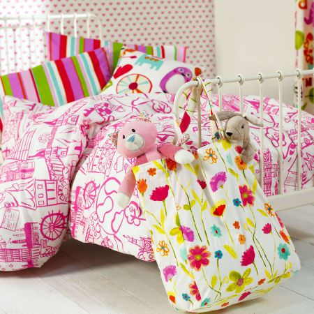 Prestigious Textiles -  Ideal World Fabric Collection - Girls bedroom, pink and white line drawing design duvet cover with brightly coloured green, pink, blue and white striped cushions