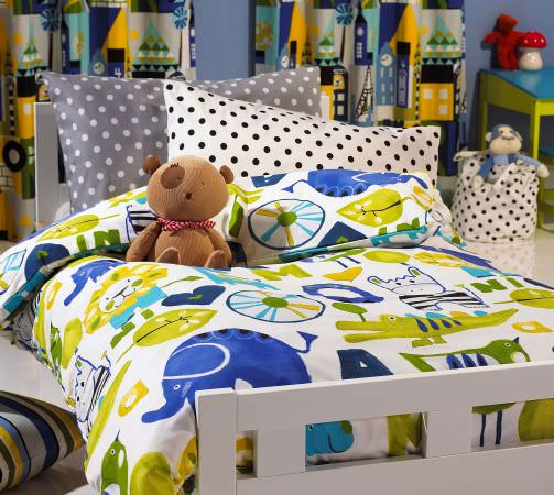 Prestigious Textiles -  Ideal World Fabric Collection - Boys bedroom - green and blue animal motif duvet cover with grey and white spotted cushions