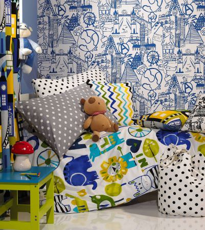 Prestigious Textiles -  Ideal World Fabric Collection - Selection of cushions for boys bedroom, animal motif, stripes, spots and zigzags in blue, green, yellow, white and grey