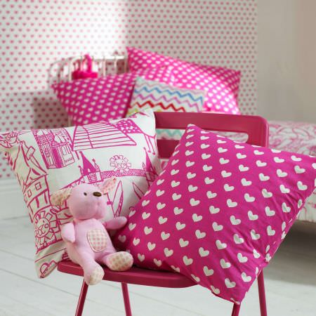 Prestigious Textiles -  Ideal World Fabric Collection - Travel and heart motif cushions for girls bedroom, bright and fun