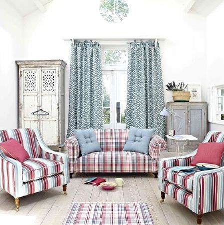 Prestigious Textiles -  Indigo Fabric Collection - Two striped armchairs, checked sofa and rug, patterned curtains, two distressed cabinets, scatter cushions, side table and anglepoise lamp