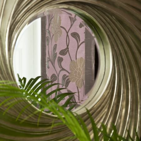 Prestigious Textiles -  Inspirations Fabric Collection - A classic light purple curtain with green edges and a classic flower and leaf pattern design