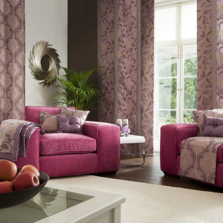 Prestigious Textiles -  Inspirations Fabric Collection - Modern upholstered red armchairs with classic designed cushions with leaves, and a light purple curtain with dark purple leaf pattern