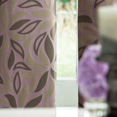 Prestigious Textiles -  Inspirations Fabric Collection - Close-up shot of a lilac curtain with green leaf pattern from the Inspirations fabric collection