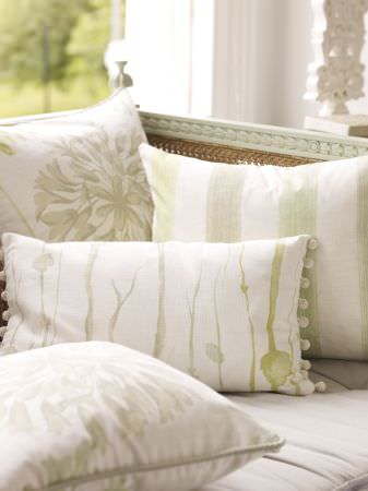 Prestigious Textiles -  Intuition Fabric Collection - White cushions with faint floral impressions, stripes and lines on a white seating pad
