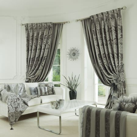 Prestigious Textiles -  Italiano Fabric Collection - Classic black and white curtains with a classic pattern, two white upholstered couches with black and white striped cushions and covers