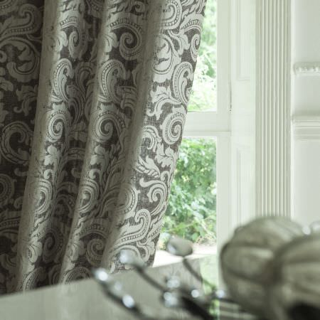 Prestigious Textiles -  Italiano Fabric Collection - Black curtain with a classic white swirly foliage design frin the Italiano fabric collection