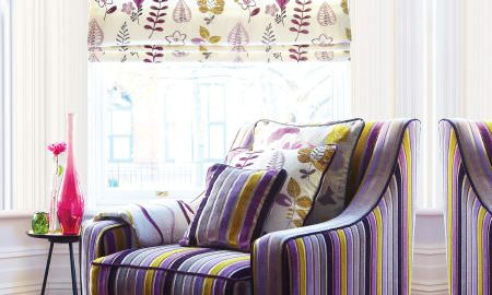 Prestigious Textiles -  Jamboree Fabric Collection - Purple and Yellow velvet striped armchair with matching striped and floral cushions, and leaf motif Roman blind