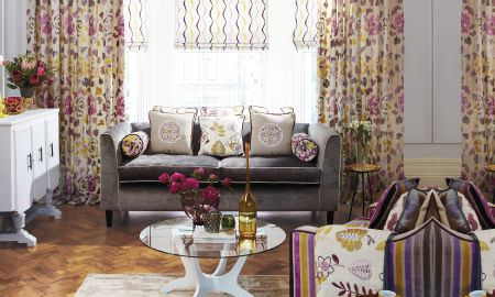 Prestigious Textiles -  Jamboree Fabric Collection - Retro style living room with velvet sofa, floral, stripe and leaf theme with purple and yellow detail