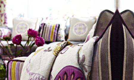 Prestigious Textiles -  Jamboree Fabric Collection - Comfy cream throw with purple and yellow detail, to match purple and yellow striped velvet sofa