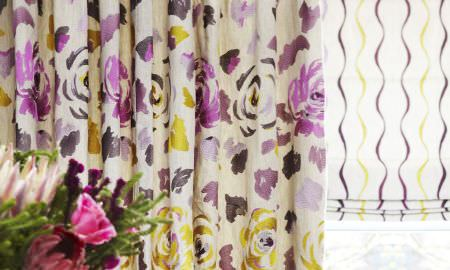 Prestigious Textiles -  Jamboree Fabric Collection - Jamboree Collection presents rose pattern curtains in yellos and purples, with matching zizag striped Roman blind