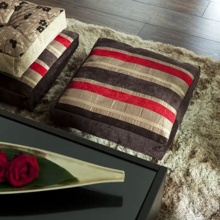 Prestigious Textiles -  Kansai Fabric Collection - Square cushions with red and brown stripes, and a champagne yellow cushion with black floral pattern