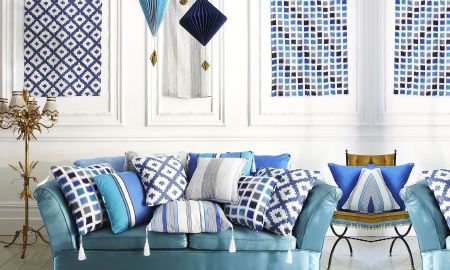 Prestigious Textiles -  Lakota Fabric Collection - Light and airy seating area, blue and white theme of square mosaics, stripes in cushions and mood boards