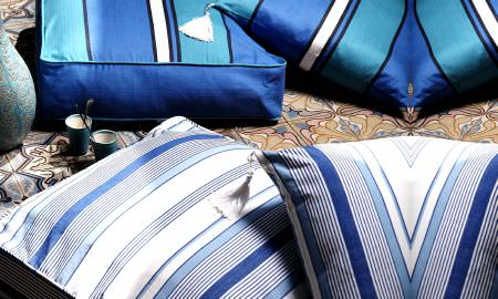 Prestigious Textiles -  Lakota Fabric Collection - Cushions in shiny fabrics, in shades of blue and white from the Lakota Fabric Collection