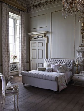 Prestigious Textiles -  Langdale Fabric Collection - Patterned curtains and a padded sleigh style bed with subtly patterned bedding and cushions, all in pale shades of grey