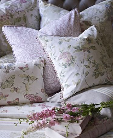 Prestigious Textiles -  Langdale Fabric Collection - Pale green, white and pink shades making up stripes and floral, paisley and butterfly prints on various scatter cushions